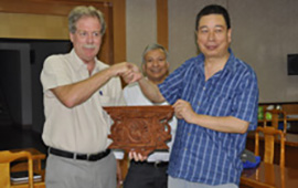 Dr David Molden hands over a peacock window to Prof Ren Jiawen as a souvenir from Nepal during a visit to CAREERI in Lanzhou, China.