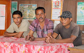 Community leader Bal Bahudur Thapa and other forest group members
