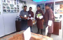 Hon. Minister Yeshey Dorji learn about Cool Chamber and bio-briquette technology at the ICIMOD stall