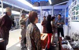 Visitors learn about Cool Chamber and bio-briquette technology at the ICIMOD stall