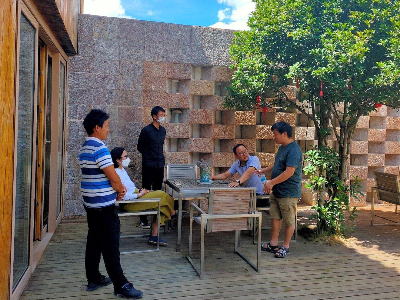 Participants discussing guesthouse design